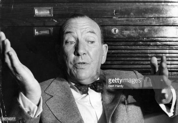 British playwright actor and song writer Noel Coward during an interview with reporters at Dublin Airport Original Publication Picture Post 8699...
