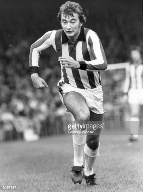 Stoke City's Alan Hudson in action