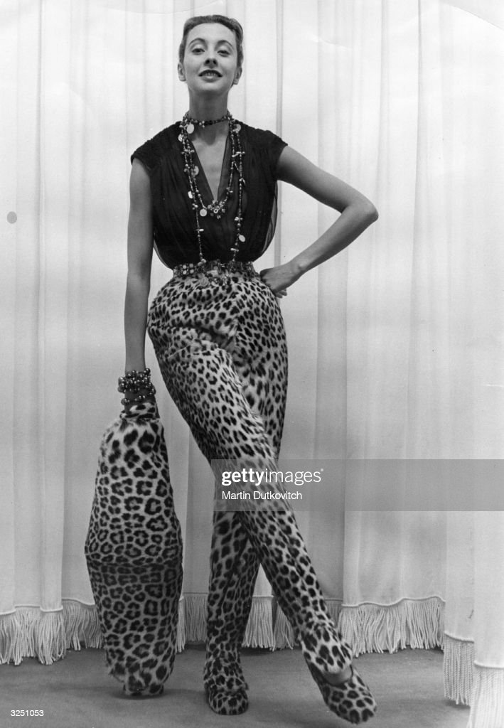 A pair of leopardskineffect slacks which cover their matching slippers and large cigarshaped muff by Parisian designer Pierre Balmain Original...