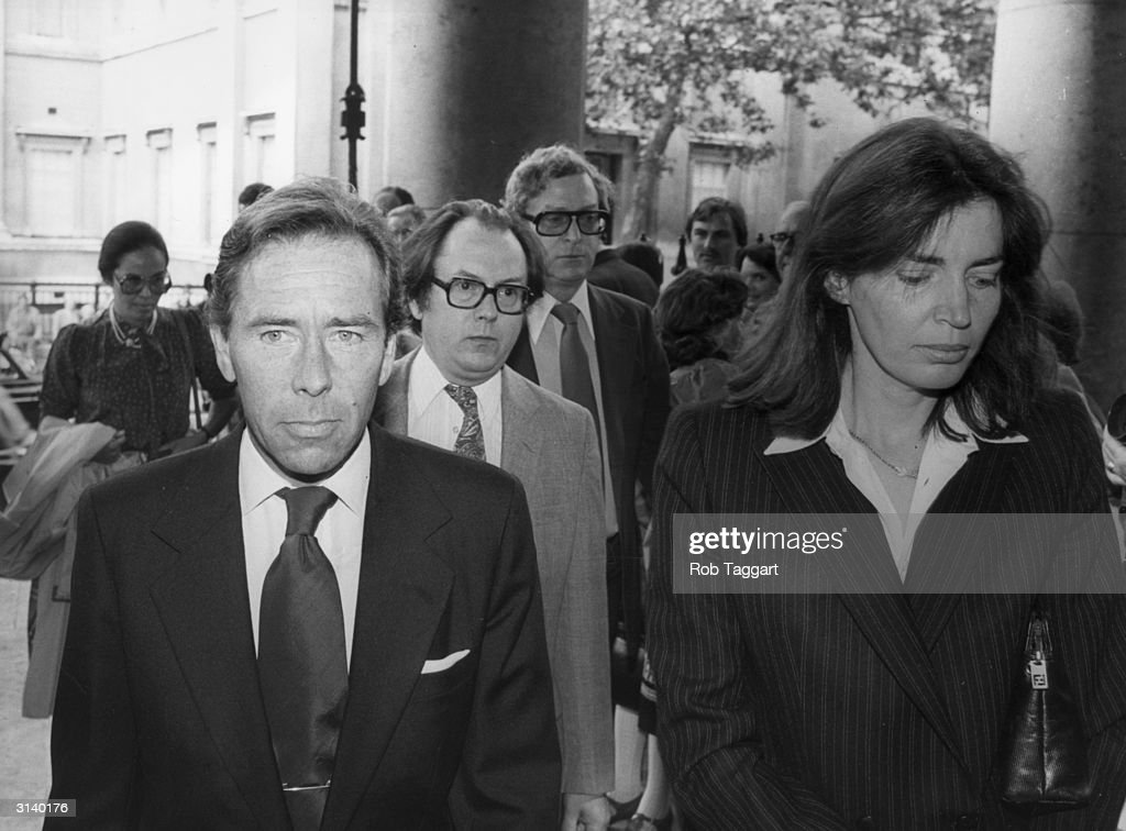 Antony Armstrong-Jones, 1st Earl of Snowdon, and second wife Lucy at the memorial service for actor Peter Sellers at St Martin-in-the-Fields, London. Film star Michael Caine is in the centre background. Lord Snowdon is the divorced husband of Princess Margaret, sister of Queen Elizabeth II.