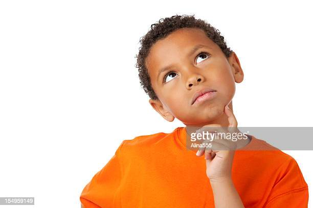 8-year old mixed race boy thinking on white