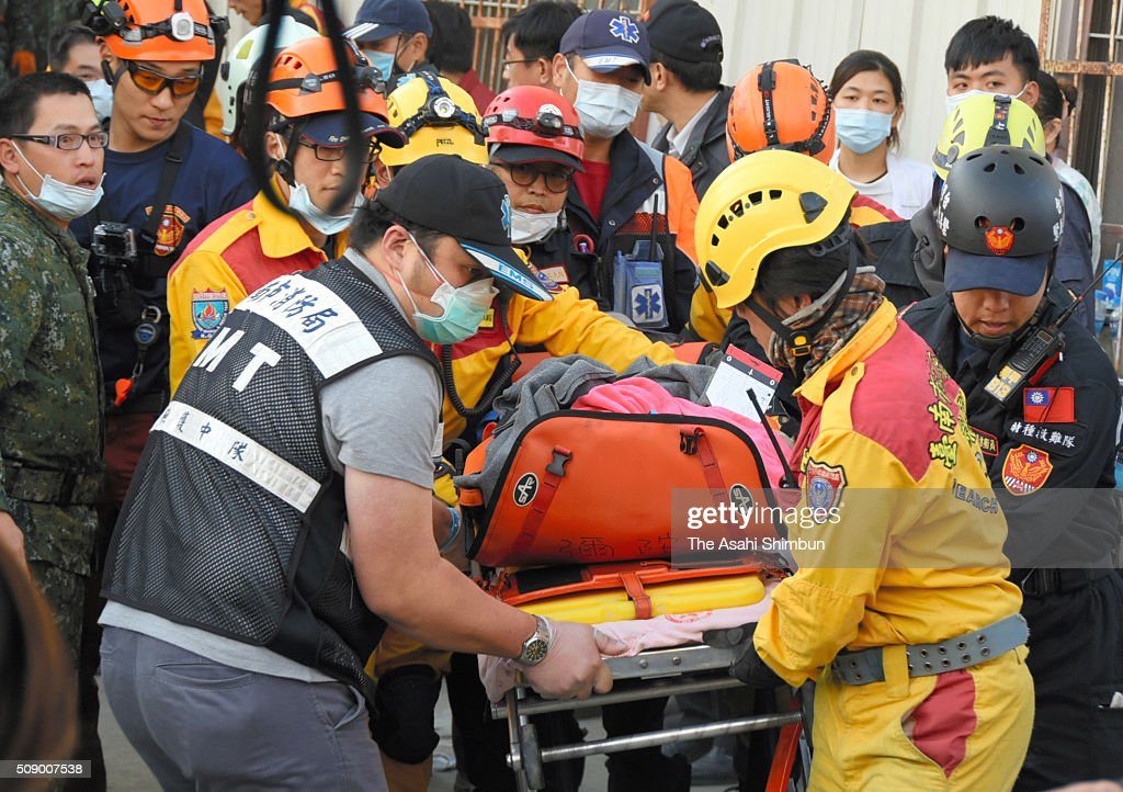 A 8-year-old girl is carried by rescue workers at a collapsed building 61 hours after the magnitude 6.4 earthquake jolted on Saturday on February 8, 2016 in Tainan, Taiwan. The crucial 72-hour approaching, more than 100 people are believed to be trapped in the building.
