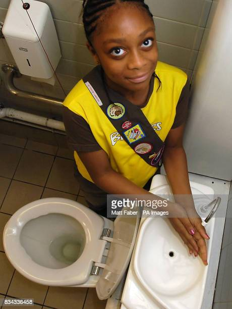8yearold Jackie from the First North Lambeth Girl Guides at London's Science Museum demonstrating the toilet lid sink which saves water by using hand...