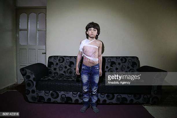 8yearsold Syrian refugee Fadi Baseem Saleh fled from Syria's Idlib due to ongoing civilwar poses at a house in Turkey's Syrian border city Hatay's...