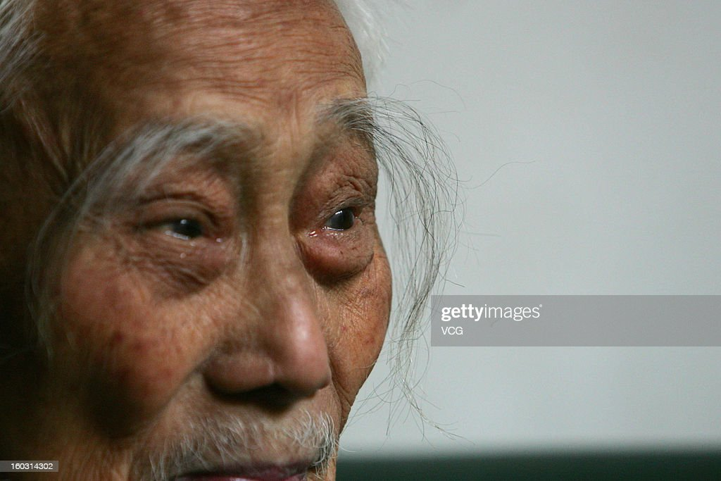 90-year-old Luo Zhicheng has more than 10 centimeter long eyebrows on October 24, 2012 in Chengdu, China.
