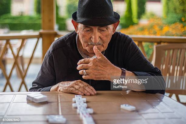 A 90yearsold member of the Aqsaqal club plays dominoes at the area of the club in Qrmz Qsb or Red Town Quba district of Azerbaijan on 28 September...