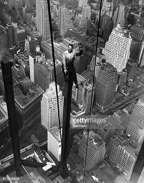 9/13/1930New York City Carl Russell waves to his coworkers on the structural work of the 88th floor of the new Empire State Building When complete...