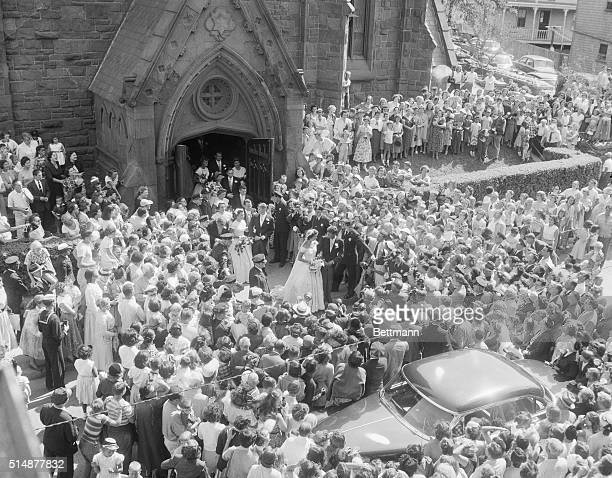 Hundreds jammed outside the centuryold church of St Mary's in Newport to catch a glimpse of Senator John F Kennedy and his bride the former...