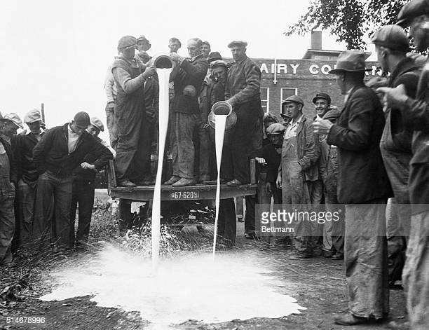 9/16/1933Striking dairy famrers of the Chicago district spilling milk from one of the nonstriker's trucks near Harvard IL where they are operationg...