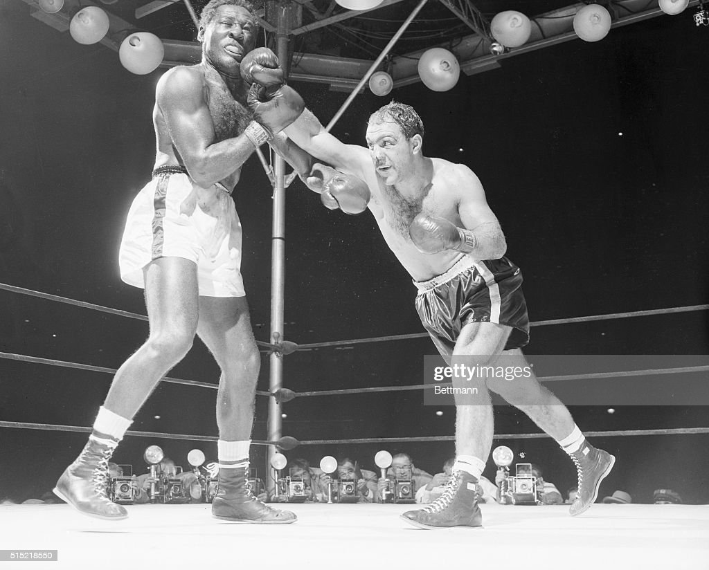 New York, NY-This was the big punch that weakened challenger Ez Charles for his 8th round slaughter. Moments after Champ <a gi-track='captionPersonalityLinkClicked' href=/galleries/search?phrase=Rocky+Marciano&family=editorial&specificpeople=94011 ng-click='$event.stopPropagation()'>Rocky Marciano</a> landed the powerful straight right, Ez hit the canvas. He managed to get up, but Marciano sent him to the canvas for keeps at 2:36 of the round.