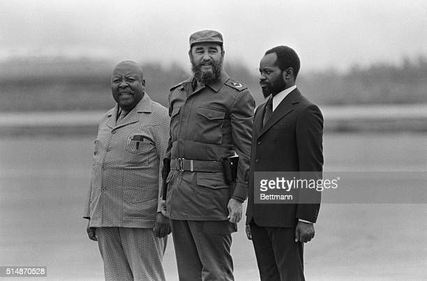 Cuban President Fidel Castro is flanked by Leabua Jonathan Prime Minister of Lesotho and Samora Moises Machel President of Mozambique on their...
