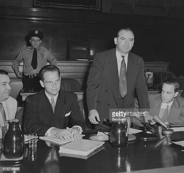 9/18/1953New York NY Sen Joseph RMcCarthy stands before a crowded courtroom as his Senate Permanent Investigating Subcommittee holds a hearing During...