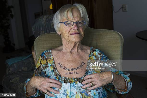 91oneyear old Nel Bolten has a tattoo on her chest that says 'Do not reanimate I am 91' on November 15 2014 in The Hague The Netherlands Dutch Health...