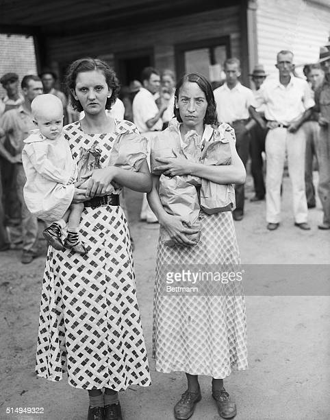 9/20/1934Belmont NC Mrs J W Ingle and Mrs James Cloninger both of this textile manufacturing town shown leaving a local strike relief station laden...