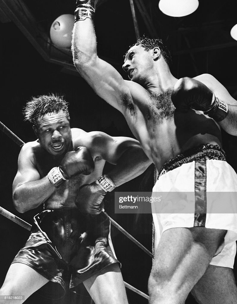 New York, NY- <a gi-track='captionPersonalityLinkClicked' href=/galleries/search?phrase=Rocky+Marciano&family=editorial&specificpeople=94011 ng-click='$event.stopPropagation()'>Rocky Marciano</a> (r) misses with a wild right in the third round of tonight's title bout with <a gi-track='captionPersonalityLinkClicked' href=/galleries/search?phrase=Archie+Moore&family=editorial&specificpeople=93092 ng-click='$event.stopPropagation()'>Archie Moore</a>. Rocky retained his heavyweight crown when he knocked out the challenger at 1:19 of the ninth round.