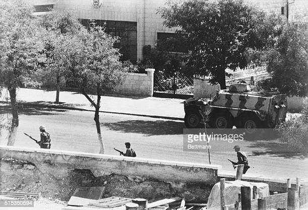 9/23/1970Amman Jordan Jordanian troops and an armored car cautiously advance down a street here as the battle with Palestinian guerrillas continues...