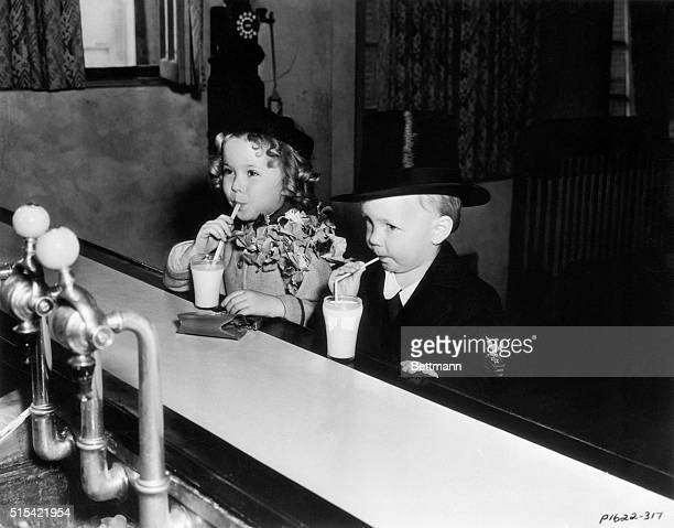 9/24/1934Los Angeles CA Aha The scandal columnists have spotted them Baby Leroy is arm and arming it with Shirley Temple The baby stars are shown...