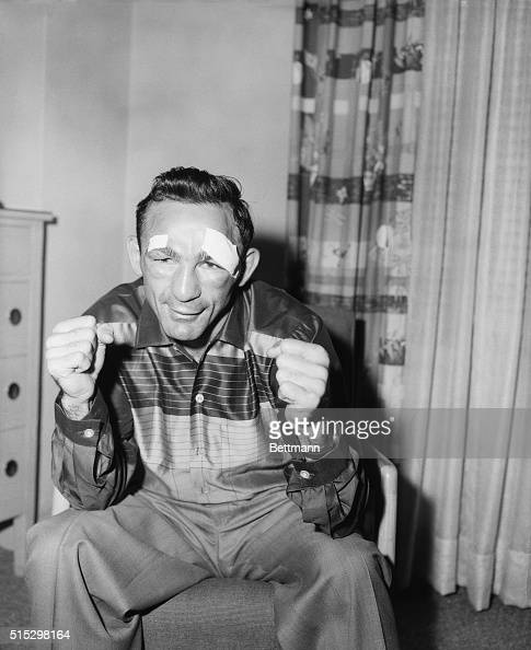 9/24/1957New York NY A closeup of middleweight champion Carmen Basilio with patches above his eyes after he was stiched up by a doctor Carmen who's...