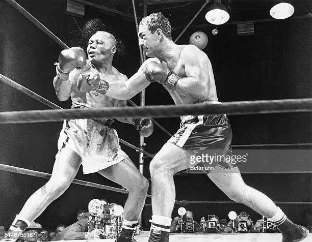 9/24/52Philadelphia Pennsylvania INP photographer Herb Scharfman was as precisely 'on the button' as was the challenger when Rocky Marciano drove his...