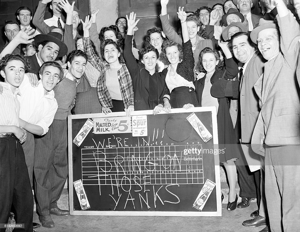 9/25/1941New York NY Flushed with triumph and filled with confidence in their idols the Brooklyn Dodgers after learning from a scoreboard on a candy...