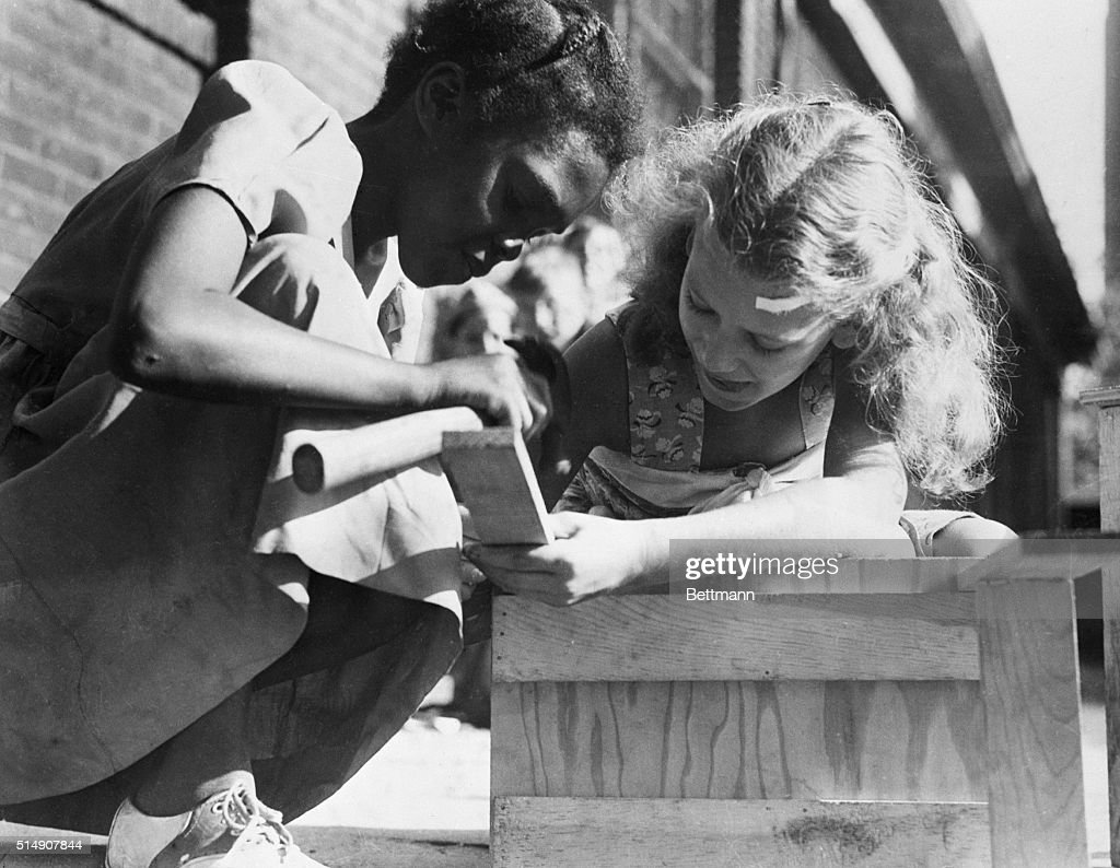 Philadelphia,PA - At Friends' Select School Playground, children work together as part of program of interracial relations prepared by American Junior Red Cross in the southeastern Pennsylvania chapter, Philadelphia. Theme of the program is 'Now All Together.'