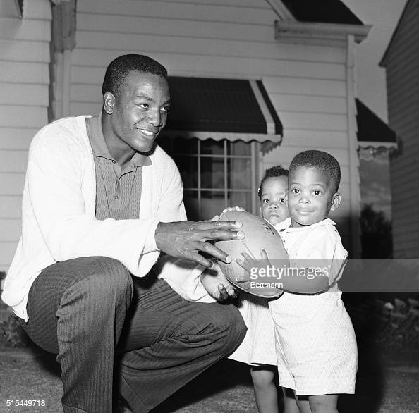 Jim Brown with Twin Children and Football Pictures | Getty ...