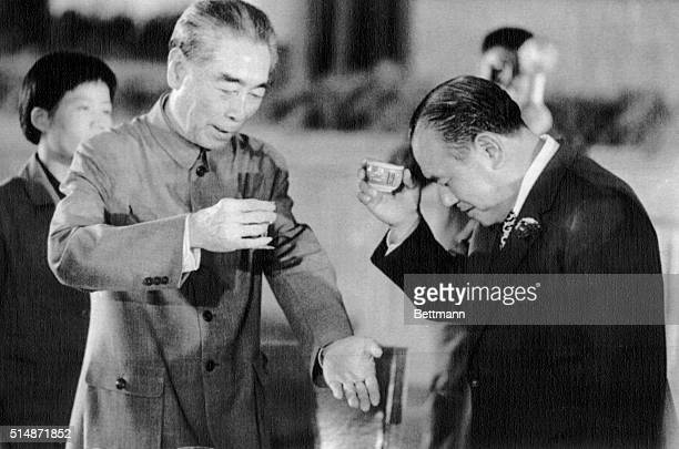9/28/1972Peking China Japanese Prime Minister Kakuel Tanaka bows head and raises cup of Sake as he drinks toast with Chinese Premier Chou Enlai...