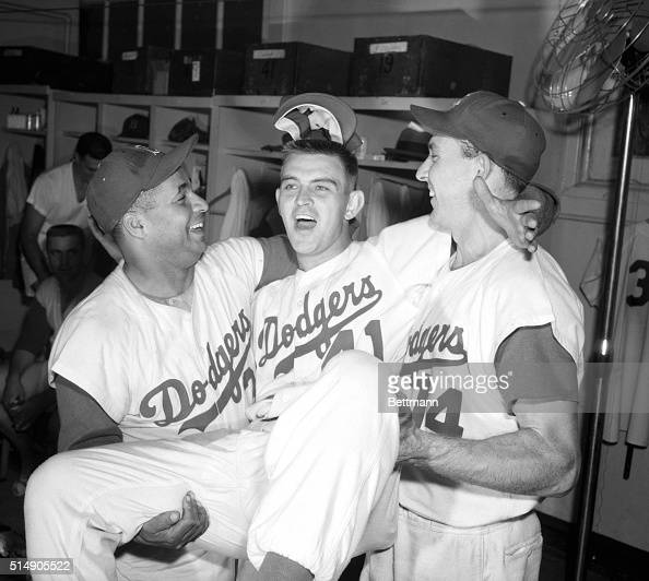 9/29/1956New York NY One of the many happy scenes in the Dodger dressing room after they copped a twin bill against the Pirates today and moved into...