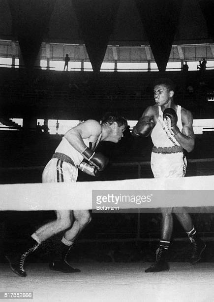 9/3/1960Rome Italy Cassius Clay of Louisville Kentucky throws a hard right at Australia's A Madigan during their lightheavyweight semifinal of the...