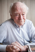 93-year-old man looking kindly at the camera
