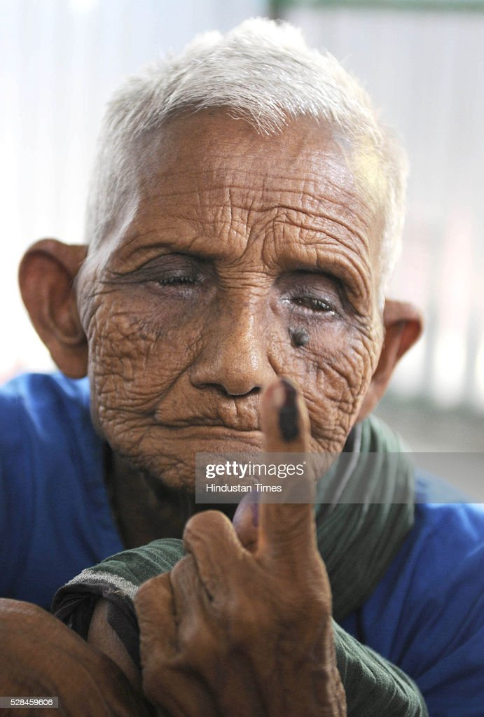 95 years old Amartya Barman was Bangladeshi enclave dweller and now is staying in Dinhata showing his ink stained finger after casting his vote for the first time in India on May 5, 2016 in Coochbehar, India. More than 9,800 of the 10,100 eligible voters in former Bangladeshi enclaves of West Bengals Cooch Behar have enrolled for the voter list, signalling exceptional enthusiasm among the people who became Indian citizens less than nine months ago. These people have lived in a virtual no-mans land for 68 years because of a complex territorial division, which created enclaves or islands of foreign territory inside each country along the Indo-Bangladesh border. The two countries agreed in 2015 to swap the almost 200 enclaves located in one country but officially belonging to the other.