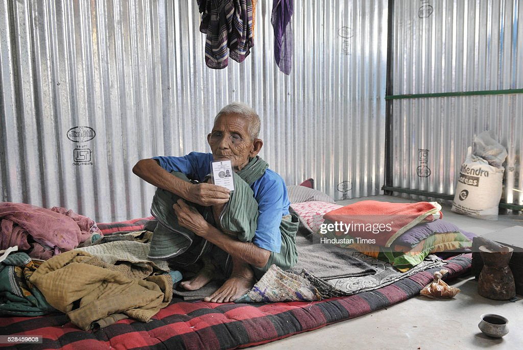 95 years old Amartya Barman was Bangladeshi enclave dweller and now is staying in Dinhata showing voter I card before casting his vote for the first time in India on May 5, 2016 in Coochbehar, India. More than 9,800 of the 10,100 eligible voters in former Bangladeshi enclaves of West Bengals Cooch Behar have enrolled for the voter list, signalling exceptional enthusiasm among the people who became Indian citizens less than nine months ago. These people have lived in a virtual no-mans land for 68 years because of a complex territorial division, which created enclaves or islands of foreign territory inside each country along the Indo-Bangladesh border. The two countries agreed in 2015 to swap the almost 200 enclaves located in one country but officially belonging to the other.