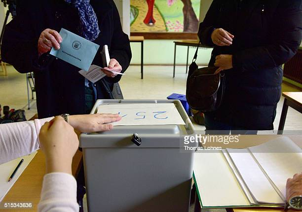 A 95years old woman gives her ballot in RhinelandPalatinate state elections on March 13 2016 in Bad Kreuznach Germany State elections taking place...
