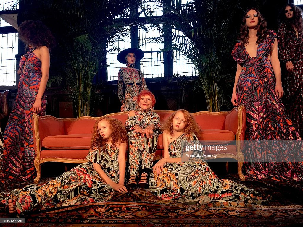 96-years-old artist Ilona Royce Smithkin (C) and models wear creations of Mara Hoffman's fall-winter 2016/2017 fashion collection presented at the High Line Hotel within New York Fashion Week on February 14, 2016 in New York, USA.
