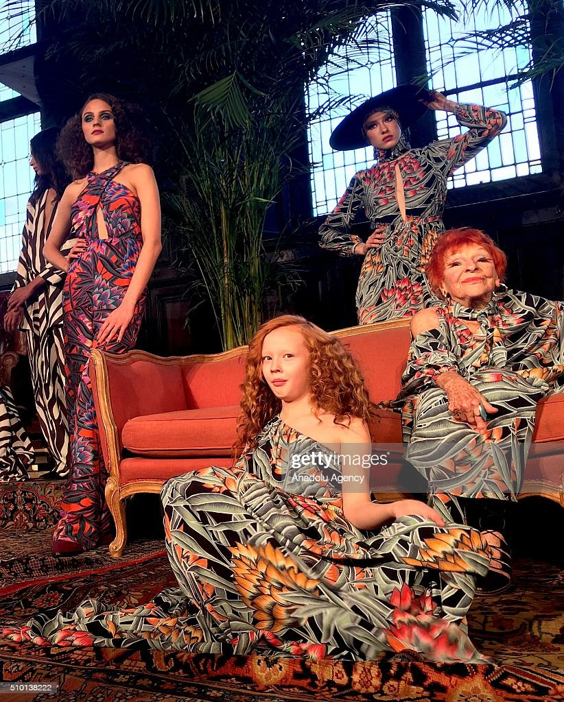 96-years-old artist Ilona Royce Smithkin (R) and models wear creations of Mara Hoffman's fall-winter 2016/2017 fashion collection presented at the High Line Hotel within New York Fashion Week on February 14, 2016 in New York, USA.