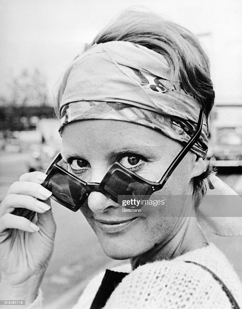 London, England - 'Hi, there,' she seems to be saying. And if you can see under those curiously shaped sunglasses, you'll recognize the gal as singer <a gi-track='captionPersonalityLinkClicked' href=/galleries/search?phrase=Petula+Clark&family=editorial&specificpeople=208081 ng-click='$event.stopPropagation()'>Petula Clark</a>. The popular entertainer flew here from Paris for television appearances.