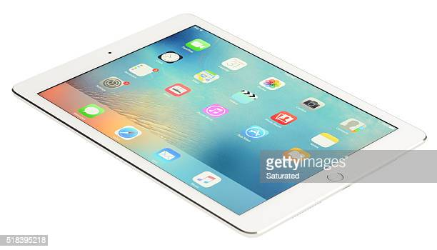 9.7-inch iPad Pro in Silver And White Showing Home Screen