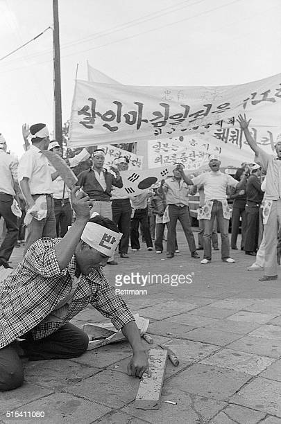 9/9/1974Seuol South KoreaAs fellow protesters look on chanting a South Korean demonstrator uses big knife to chop off his little finger during...