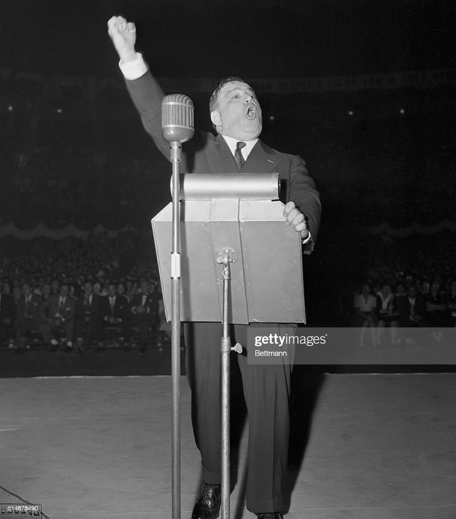 Mayor <a gi-track='captionPersonalityLinkClicked' href=/galleries/search?phrase=Fiorello+La+Guardia&family=editorial&specificpeople=93387 ng-click='$event.stopPropagation()'>Fiorello La Guardia</a> raises his arm in what almost looks like a fascist salute, as he addresses an Italian-American 'Free Italy' rally at Madison Square Garden tonight. The meeting, which drew a relatively small crowd, was held to celebrate Italy's surrender.
