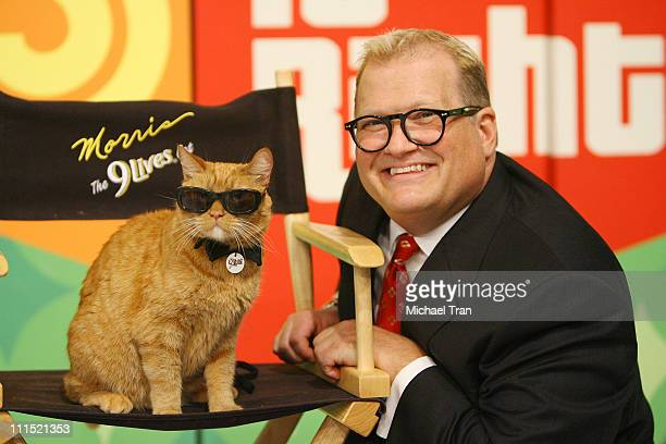 '9Lives icon Morris the Cat' poses with TV Personality Drew Carey of 'The Price is Right' to kickoff a video contest that will give cat lovers the...