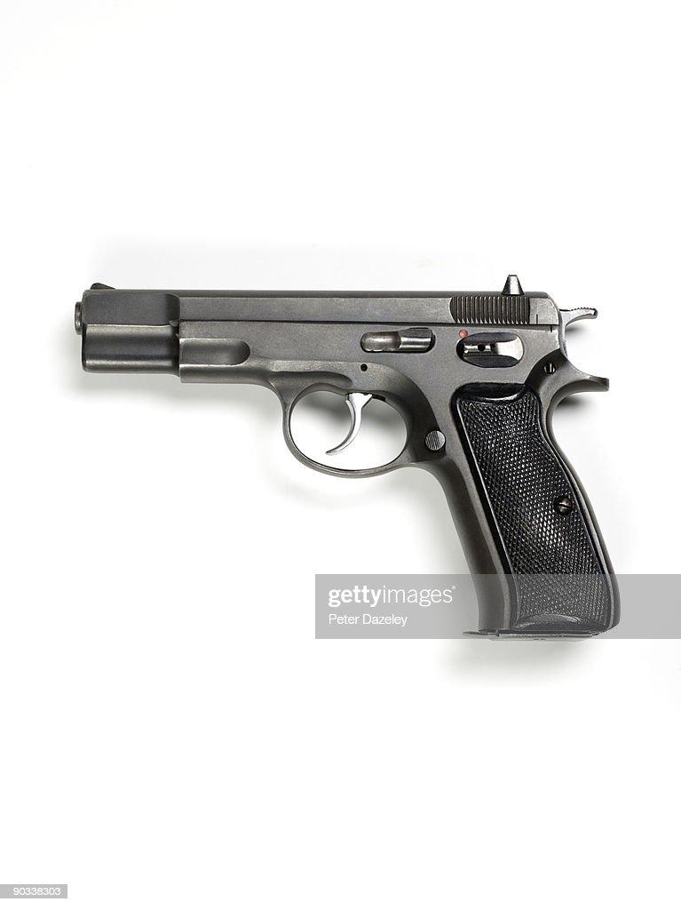 9mm hand gun on white background.
