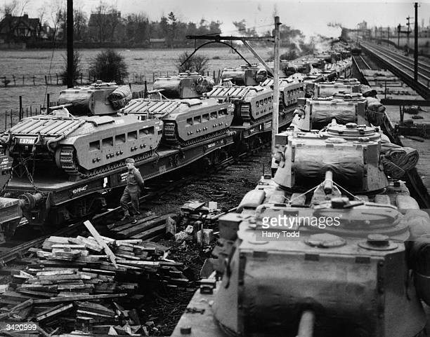 Tanks from an Ordnance factory in England are loaded on to a train for the first step of their journey to the Russian front They are Infantry Tanks...