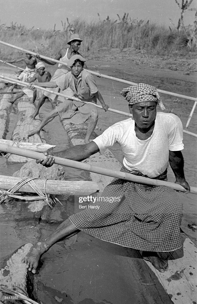 Burmese agricultural workers pushing their raft on the river Irrawaddy. Original Publication: Picture Post - 4748 - Burma: The Cold War Hots Up - pub. 1949