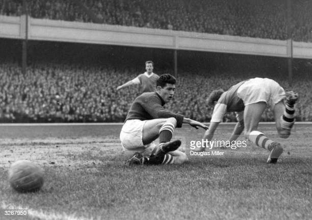 Peter Bonetti Chelsea goalkeeper on the ground in front of Arsenal leftback McCullough during their match at Highbury