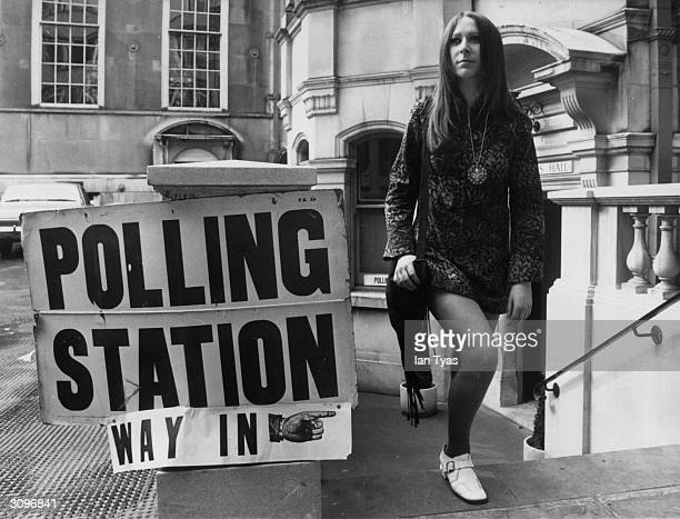 Eighteen year old Sharon Nathan leaving a London polling station during elections for the LCC which are the first elections in which eighteen year...