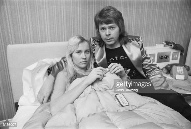 Swedish pop star Bjorn Ulvaeus of ABBA puts a reassuring arm around his fellow member of the band Agnetha Faltskog who is ill in bed