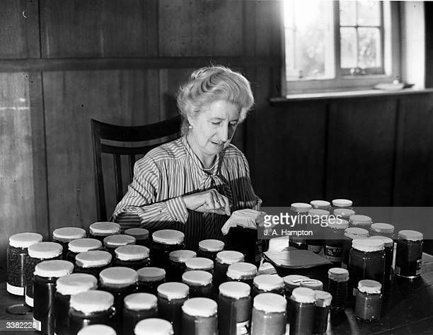 A member of the Women's Institute in Kent joins her fellow members all over England in making jam from surplus fruit supplies