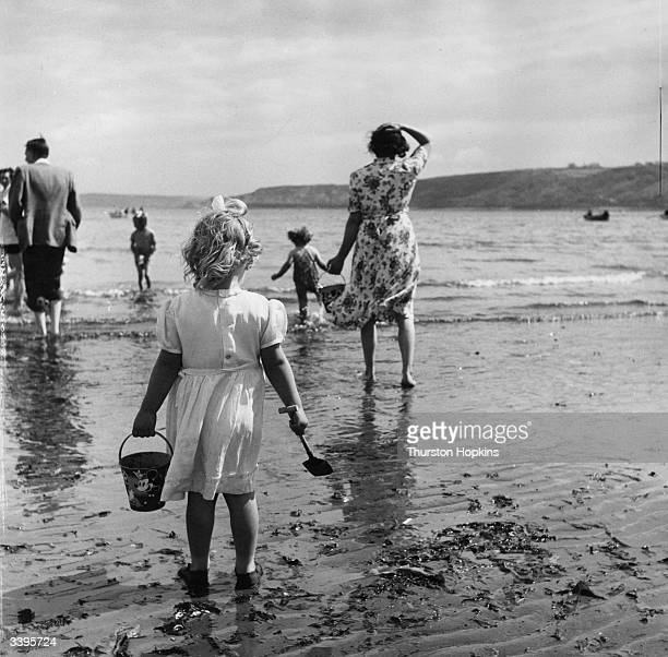 Families enjoy paddling at the seaside resort of Scarborough in North Yorkshire Original Publication Picture Post 5997 A Trip To Scarborough pub 1952