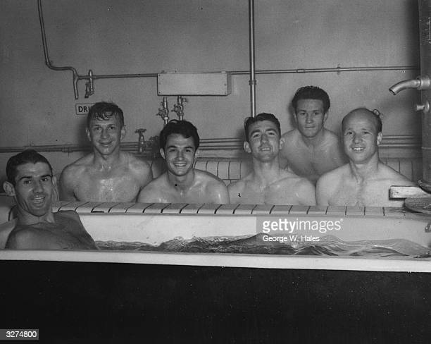 Six smiling members of Charlton Athletic Football Club including Chambers Leary Firmani and Hurst enjoy a welcome communal bath after training in the...