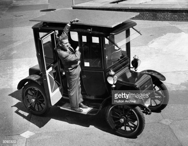 The sun powered car a 1912 Baker Electric Mode which has been adapted to run from energy obtained from the sun's rays Dr Charles Alexander Escoffery...